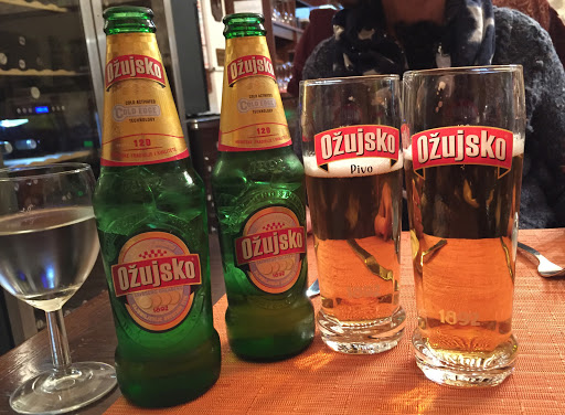 Ozujsko.jpg - Ožujsko (just don't ask me how to pronounce it!), a Croatian beer we enjoyed at a café after a long afternoon of walking the storied streets of Dubrovnik.