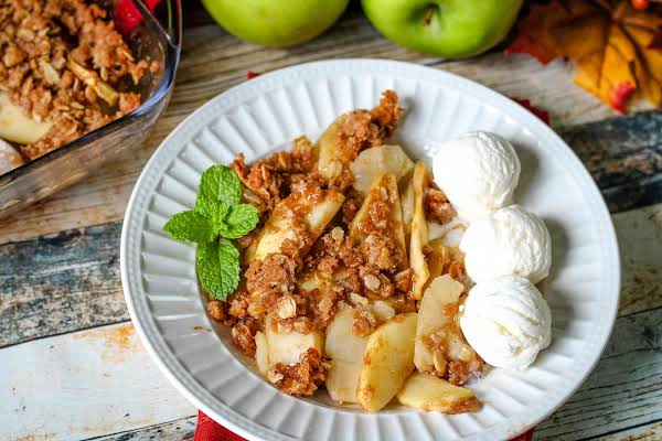 Apple Crisp On A Plate With Ice Cream.