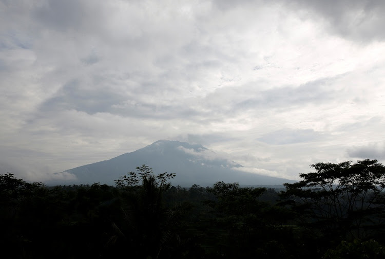 A view of Mount Agung, a volcano on the highest alert level, from a a government monitoring station and observatory in Rendang, on the resort island of Bali, Indonesia, September 24, 2017. REUTERS/Darren Whiteside