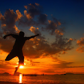 SUNSET JUMP by Assoka Andrya - People Portraits of Men