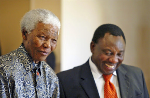 The late former South African president, Nelson Mandela, and businessman, Cyril Ramaphosa. File photo.
