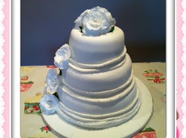 3 tiered white flowered wedding cake