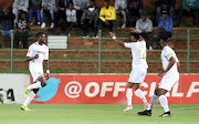 Bidvest Wits' defender Bongani Khumalo (L) celebrates with teammates after scoring a goal during the Absa Premiership match against Supersport United at Bidvest Stadium, Johannesburg South Africa on 10 January 2018. Wits won 2-0.