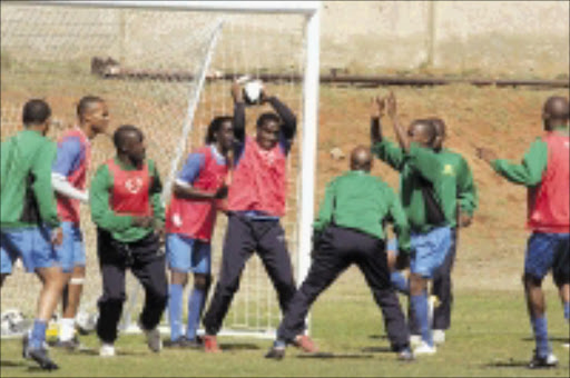HARD WORK: Mamelodi Sundowns players during a training session at Chloorkop in Kempton Park yesterday. Pic. Veli Nhlapo. 12/08/08. © Sowetan.