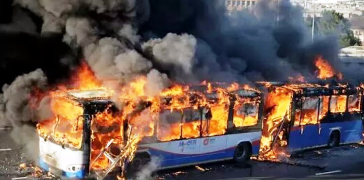 A MyCiTi bus goes up in flames during unrest in the Dunoon and Joe Slovo areas of Cape Town on September 27 2019.