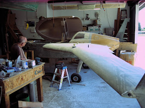 Photo: Michael takes a break from sanding and surveys just how much more there is to fill.  We were both amazed at how little fill remained on the plane after sanding.  A testament to Michael's excellent work.