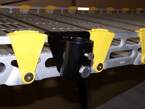 Photo: Roll-A-Ramp custom handrail brackets for aluminum ramps.
