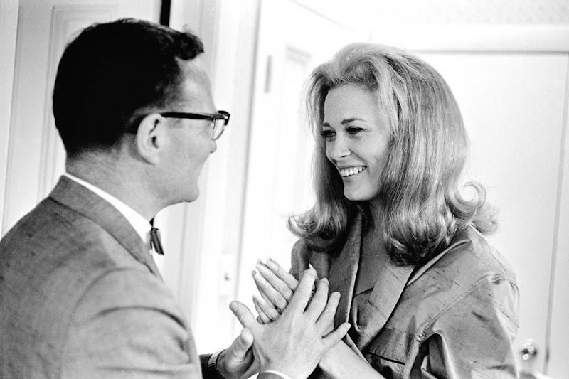"""Photo: On July 26, 1967, BU alumna Faye Dunaway met with BU Director of Financial Aid Everett Hicks on the downtown set of a shoot for """"The Thomas Crown Affair."""""""
