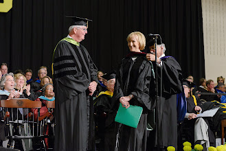 Photo: Judy Woodruff, broadcast political journalist, is hooded by Interim Provost and Professor Tom Zirpoli for honorary degree of Doctor of Journalism.  Trustee Charles Moore '71 offers congratulations.