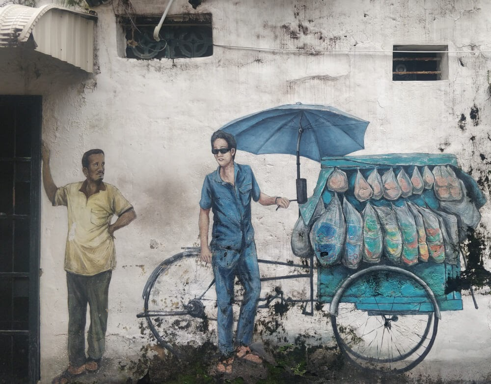 men+selling+wall+graffiti+street+art+penang+malaysia
