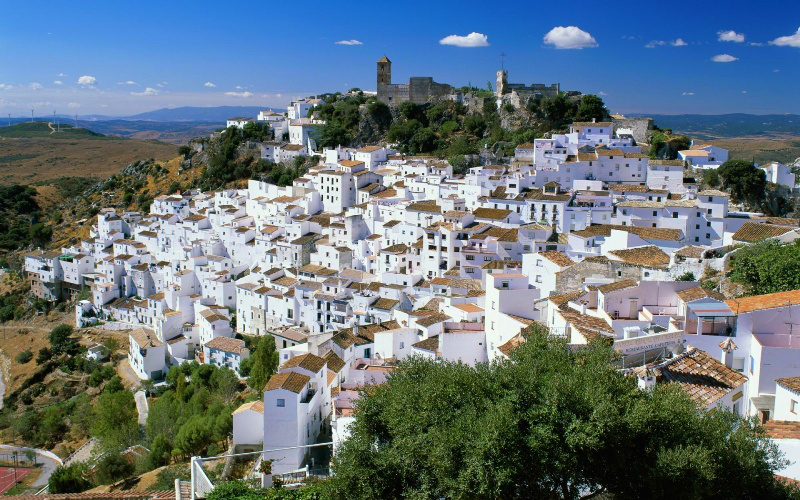 Photo: Spain This town is a pretty white Andalucian village in southern Spain with a population of about 4000 people. It is perched on a cliff and only 15 minutes drive from the coast. Can you name this town?