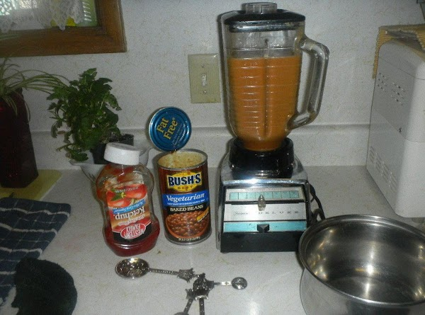 Open can of beans.  Add 1/3 cup of water in a blender, along with...