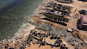 An aerial view shows water contaminated with raw sewage flowing via open channels into the ocean at Hann Bay on the eastern edge of Dakar's peninsula, whose sandy shorefront is discoloured by stagnant algae, in Dakar, Senegal, March 17, 2021.