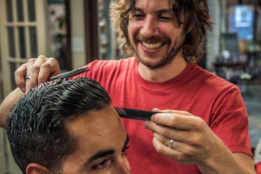 Photo of barber giving a haircut to a customer