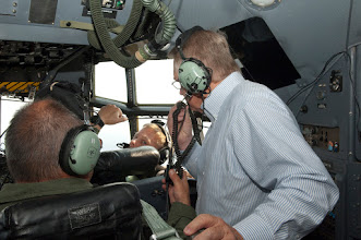 "Photo: A civilian official talks with an Airman aboard a C-130 ""Hercules"" as they participate in Metro Mayors Day at the 133rd Airlift Wing on August 19, 2010. The Minnesota National Guard units at the Minneapolis-St. Paul International Airport brought local officials on base and on a flight on a military cargo aircraft to demonstrate the capabilities that could be available once authorized for communities. www.MinnesotaNationalGuard.org photo by Senior Master Sgt. Mark Moss"