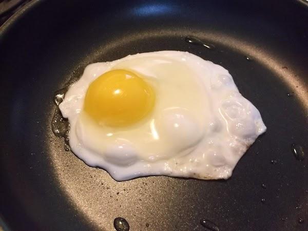 Break egg, pour into prepared skillet; cook over medium/ medium-high heat for 1 1/2...