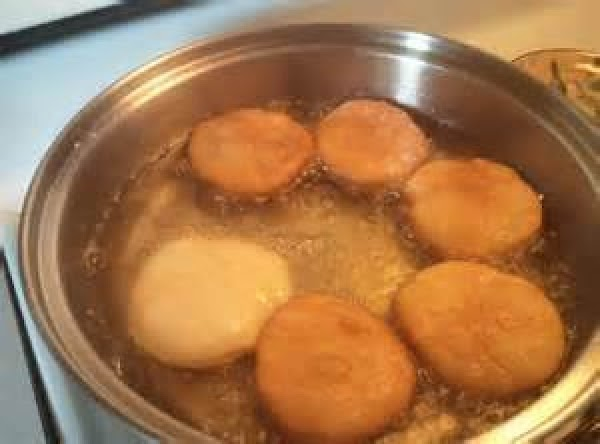 Carefully drop each biscuit into the hot oil. Deep fry them until golden brown...