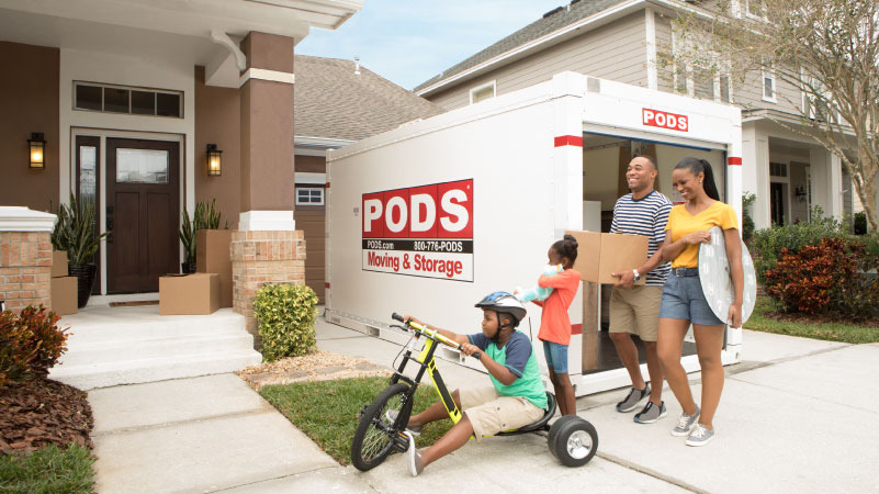 A family using a PODS container to move into their new home