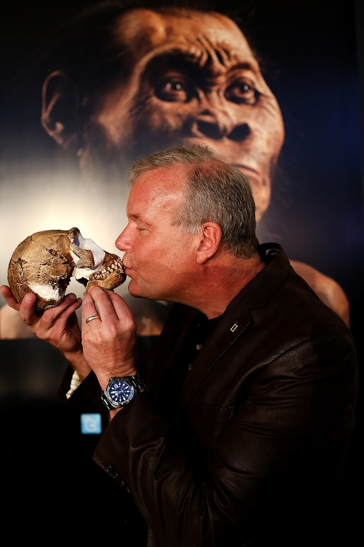 Prof Lee Berger of Wits University with a Homo naledi skull from the Rising Star cave system in the Cradle of Humankind. If DNA can be extracted from bones at the site, it could reveal whether there are links between Homo naledi and our species. Picture: ALON SKUY