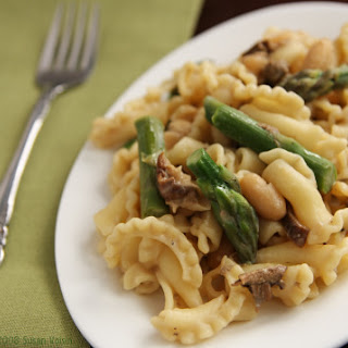 Pasta with Asparagus, Cannellini Beans, and Porcini Cream.