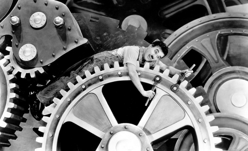 Charlie Chaplin caught in the turning wheel
