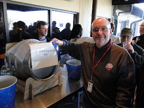Photo: Owen Ogletree places the ribbon for first place classic style on the tasty cask of Uinta Hop Notch IPA.