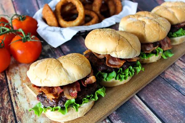 Juicy Bacon Burgers Topped With More Bacon And Lettuce.