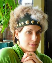 Photo: <KAPELUXE> Unique-Chique Hats by Luba Bilash ART & ADORNMENT  Dark green wool felt base, rabbit fur, silvertone & brass buttons N/A Model: Andrea K