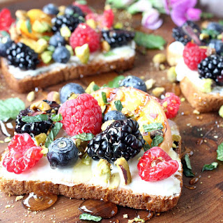 Sweet Berry & Grilled Peach Toast w/ Crushed Pistachios, Honey, Mascarpone, & Mint