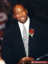 Photo: Wayman Tisdale at his jersey retirement ceremony in 1997.
