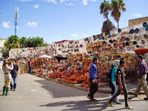 Photo: Tom and Matt buying tagine at the market in El Jadida