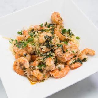 Simple Shrimp Scampi Served Over Angel Hair Pasta.