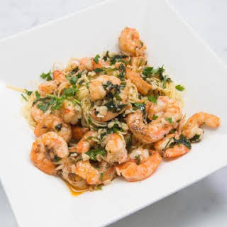 Simple Shrimp Scampi Served Over Angel Hair Pasta.