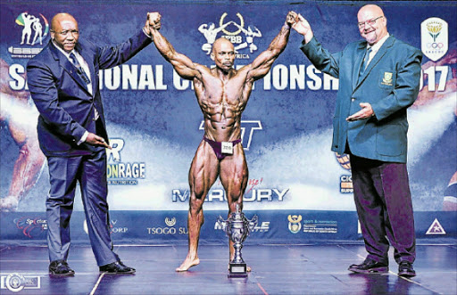 THE MAIN MAN: Mveliso Tapi, flanked by Bodybuilding South Africa vice-president Kaya Majeke, left, and president Wayne Price is crowned Mr South Africa at the 2017 IFBB SA Champs in Mpumalanga last weekend