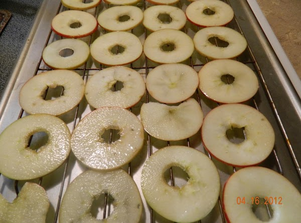 Place the apple slices, in a single layer on cooling racks that have been...