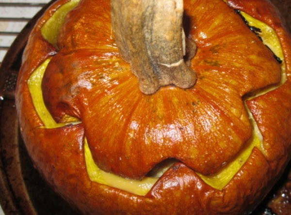Spray the filled-pumpkin with the cover/cap all over with your favorite cooking spray/oil.