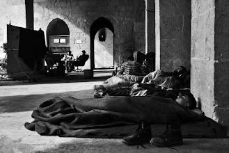 Photo: Free Syrian Army rebel fighters from the Liwa al-Tawhid brigade rest inside the Umayyad mosque located in the al-Jalloum district of the Old City of Aleppo, Syria. The Umayyad mosque and surrounding area have witnessed fierce clashes in recent weeks between rebel fighters and government forces. Aleppo, SYRIA - 11/4/2013. Credit: Ali Mustafa/SIPA Press