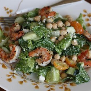 Bush's Mediterranean Caesar Salad with Lemon Pepper Shrimp and Garbanzo Beans.