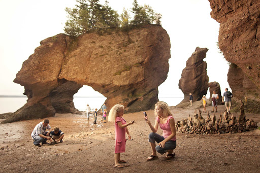 Visitors come out during low tide to explore Hopewell Rocks, northeast of Saint John, New Brunswick.