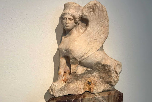 Sphinx-shaped finial of a Funerary Stele dates to 400-410 B.C. at the Altes Museum in Berlin. The winged lions with a human head were adopted by the Greeks from the Near East in the seventh century B.C.