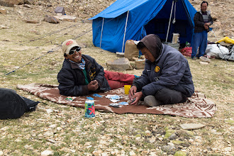 Photo: Harish and Stazin pass the time with a hand of cards at Lungser Kangri base camp.