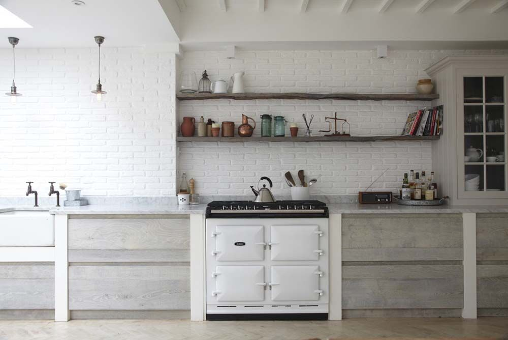 brick wall white painted open shelving classic creative atlanta design