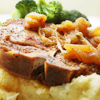 Tender Pork Chops with Caramelized Apples and Onions.