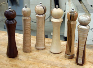 Photo: Tonight's demo will be making a peppermill. Here are a few of many made by Ed Karch recently. These are the traditional models with the adjustment at the top. One can also buy another type called the Crush Grind. Same basic idea, but they adjust from the bottom so there is no knob on top.