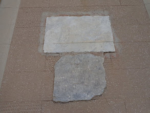 Photo: Greek inscription on lower tablet dates settlement to time of Constantine the Great, fourth century