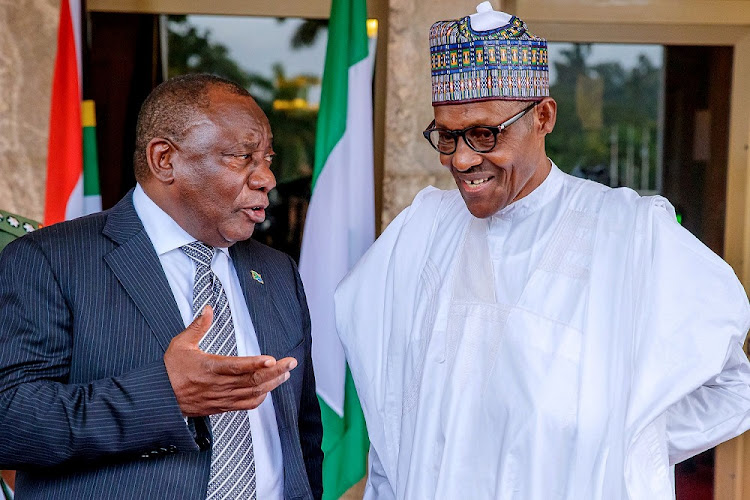 President Cyril Ramaphosa speaks to Nigerian President Muhammadu Buhari at the State House in Abuja, Nigeria, July 11 2018. Picture: REUTERS/NIGERIA PRESIDENCY