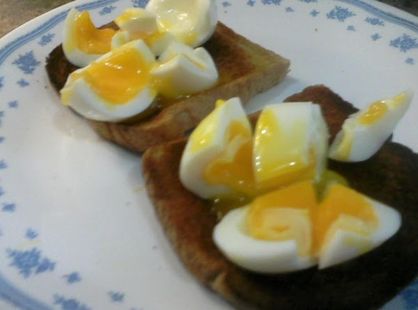 Put one egg on each slice of buttered toast.