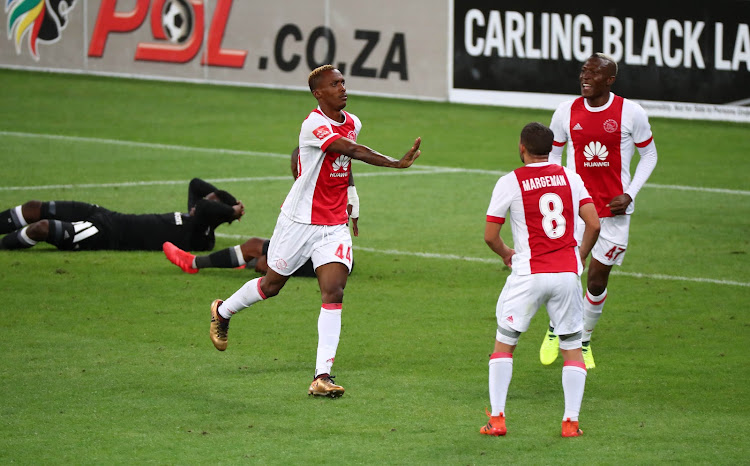 Yannick Zakri of Ajax Cape Town celebrates goal with teammates Grant Margeman (c) and Tendai Ndoro of (r) during the Absa Premiership 2017/18 football match against Orlando Pirates at Cape Town Stadium, Cape Town on 31 January 2018.