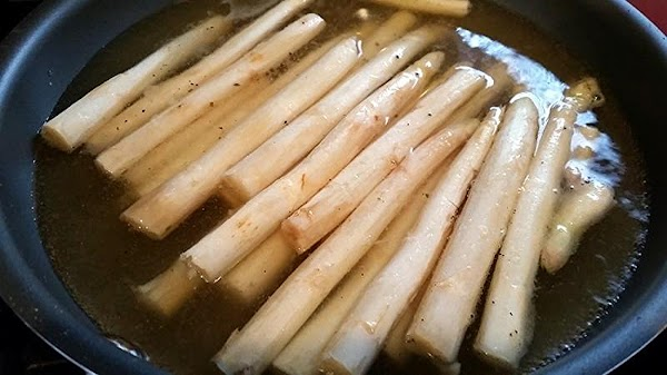 Once boiling add the asparagus and spread out evenly so it cooks evenly. Lower...