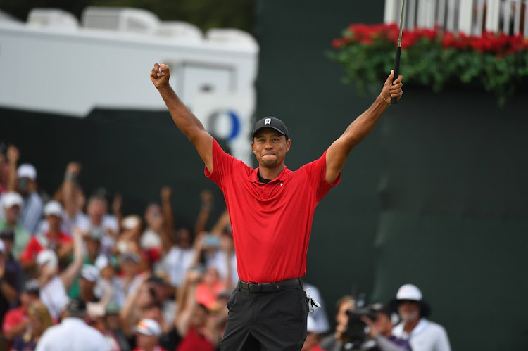 Tiger Woods reacts to win the Tour Championship golf tournament at East Lake Golf Club.